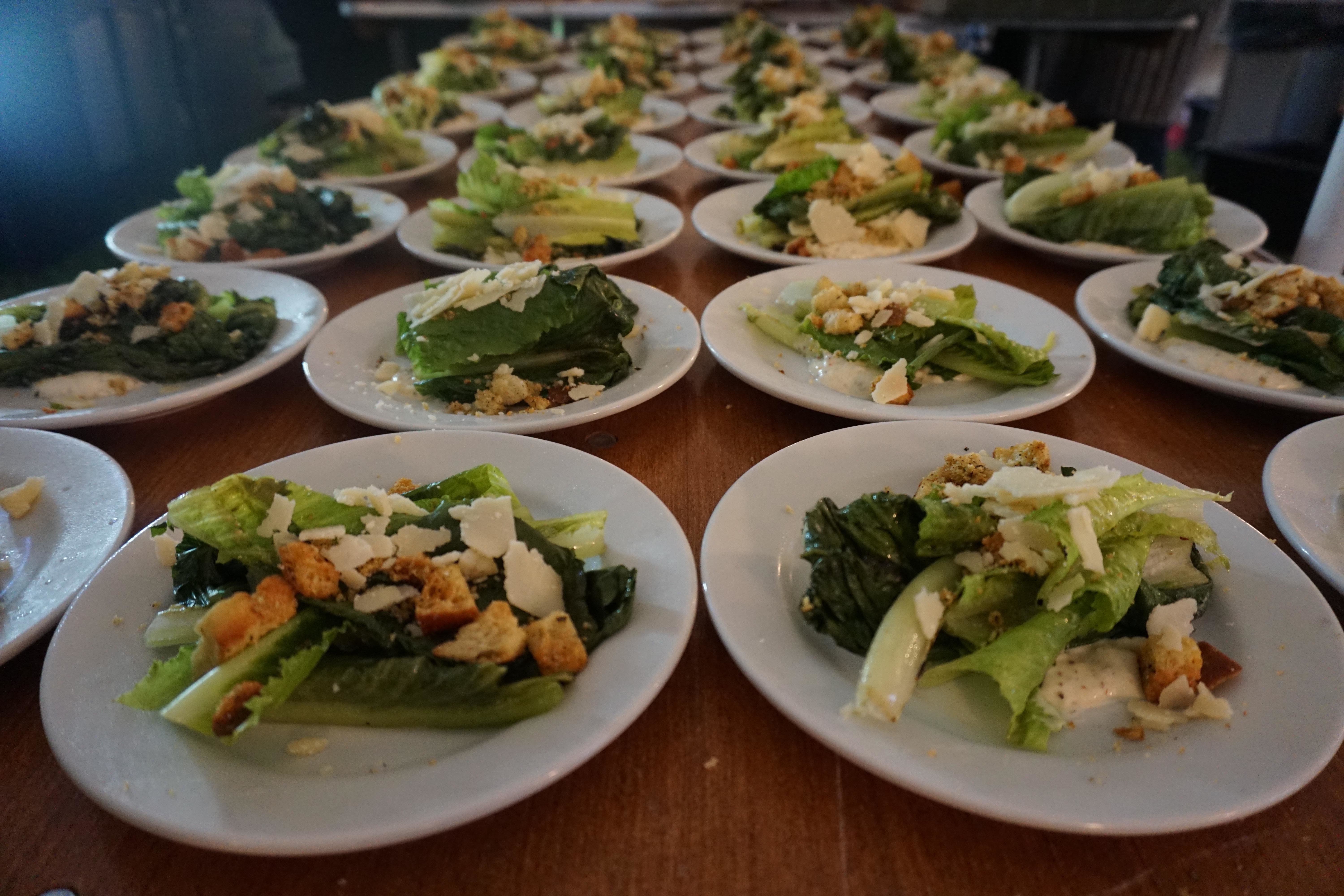 side cesar salads at catering event hosted by Liquid Assets